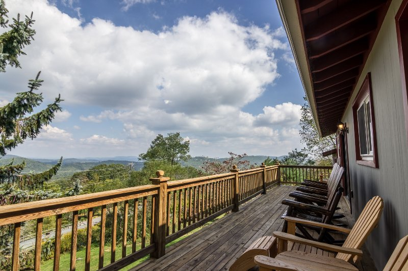 Deck with chairs and mountain views