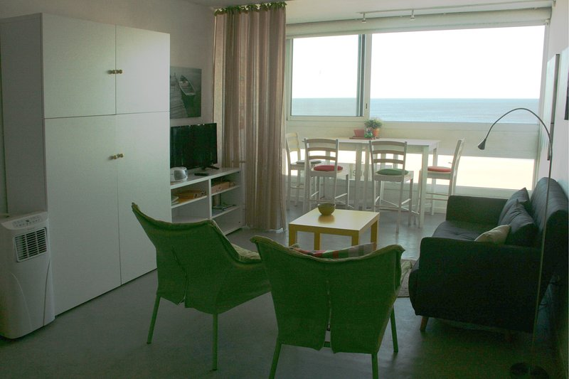 lounge, dining area, sea view