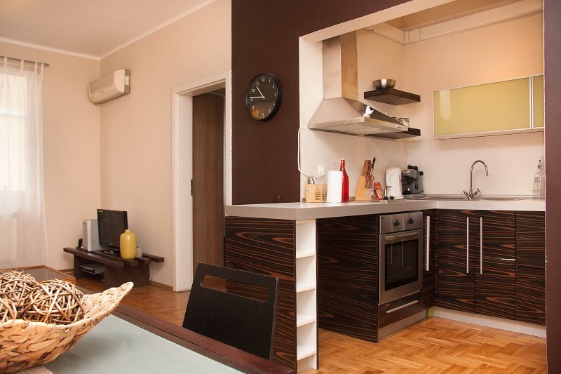 A fully equipped kitchen area