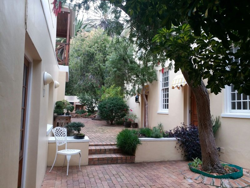 Entrance to the apartment is off a quiet and private courtyard