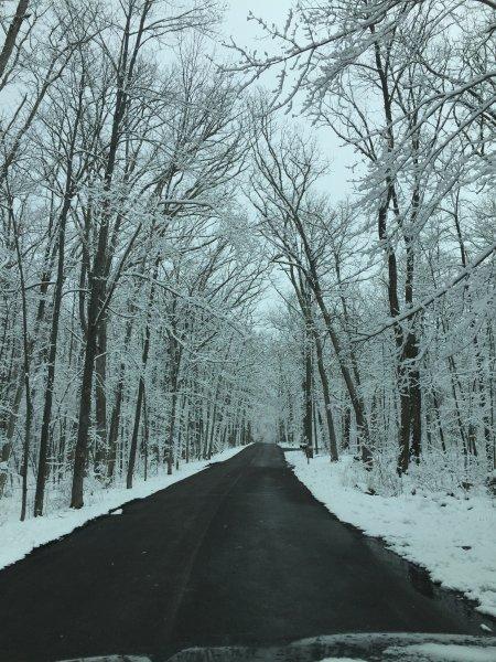 Neighborhood road after late spring snowfall