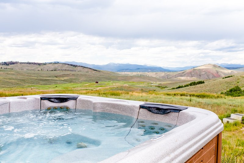 Private hot tub with an incredible view of the valley