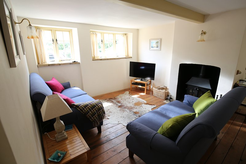 Lounge with LCD TV, freeview, wood burning stove