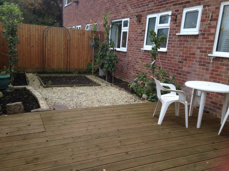 Private garden with decking area.