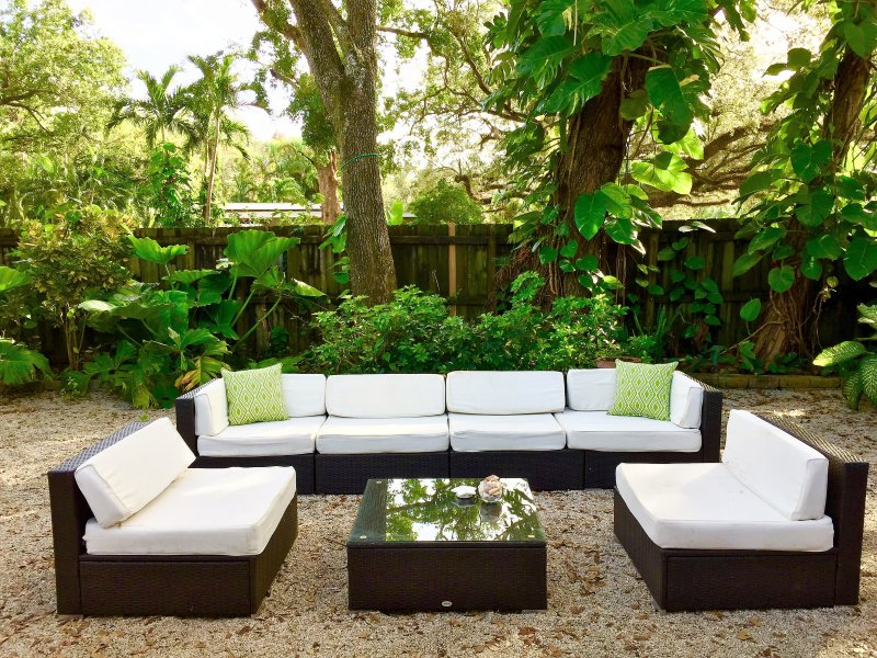 spacious backyard with lush greenery & wrap around fence for privacy