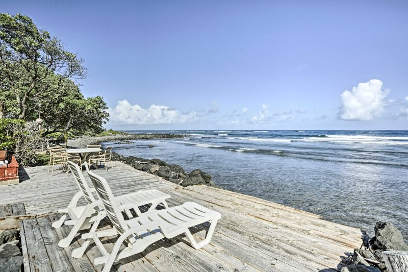 Enjoy the fresh sea breeze from this oceanfront deck.