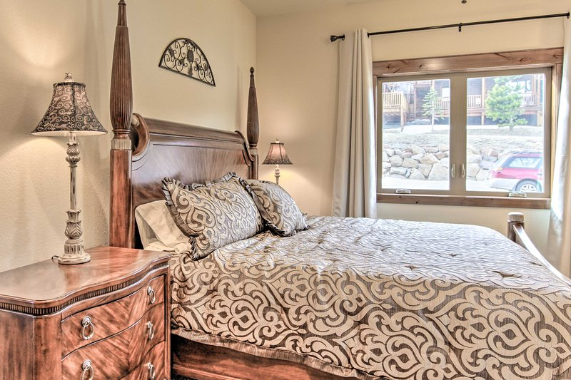 A king bed and walnut wood furnishings distinguish the master bedroom.
