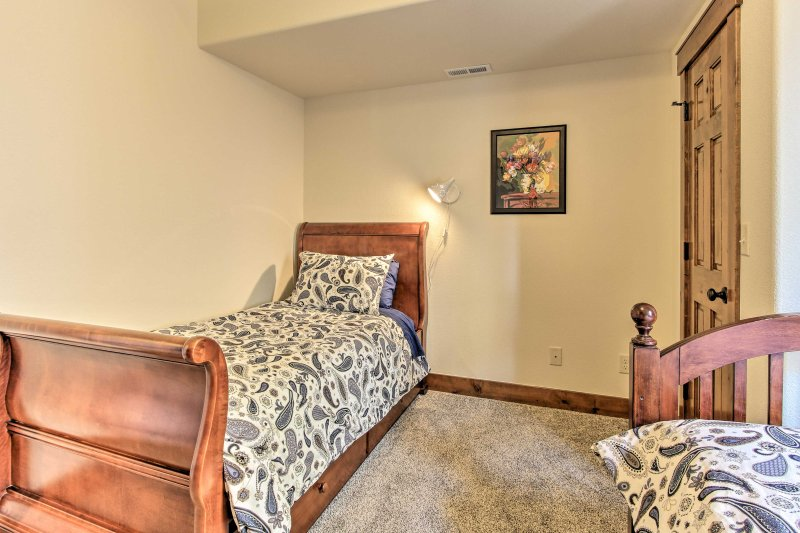 Two can share the third bedroom outfitted with 2 twin beds.