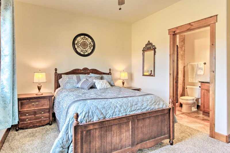 The second bedroom houses a cozy queen-sized bed.