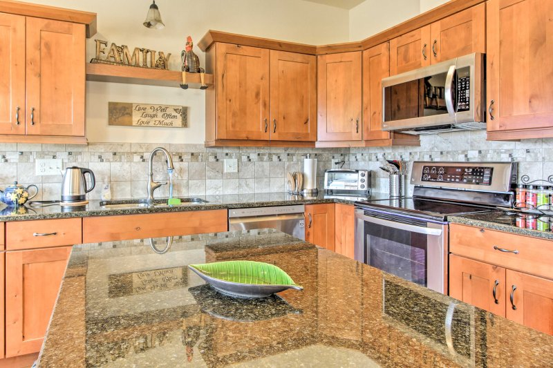 Stainless steel appliances and Alder wood cabinets highlight the kitchen.
