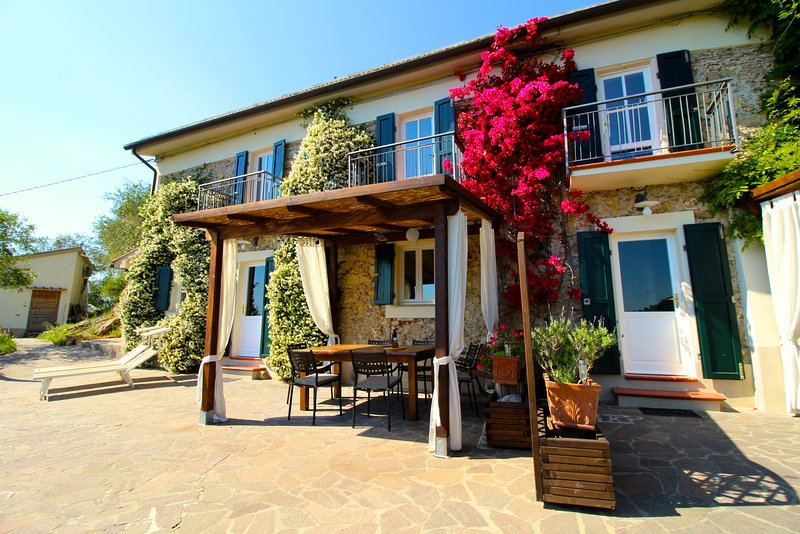 Beautiful! Front of house with shaded dining area, sun loungers, garden and great views!