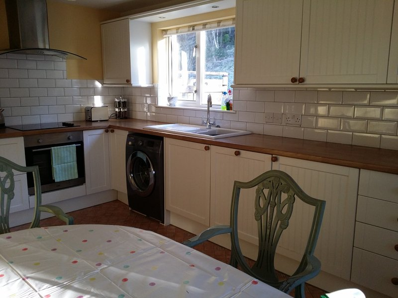 Well equipped, dual aspect, kitchen/breakfast room. Views to Aberchalder Estate.  Table and 4 chairs