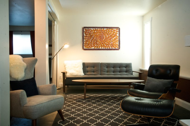 Radiant floor heat throughout and comfortable furniture in the living room.