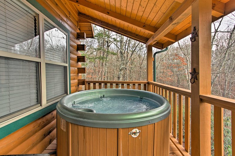 Soak in the private hot tub to relax after a long hike.