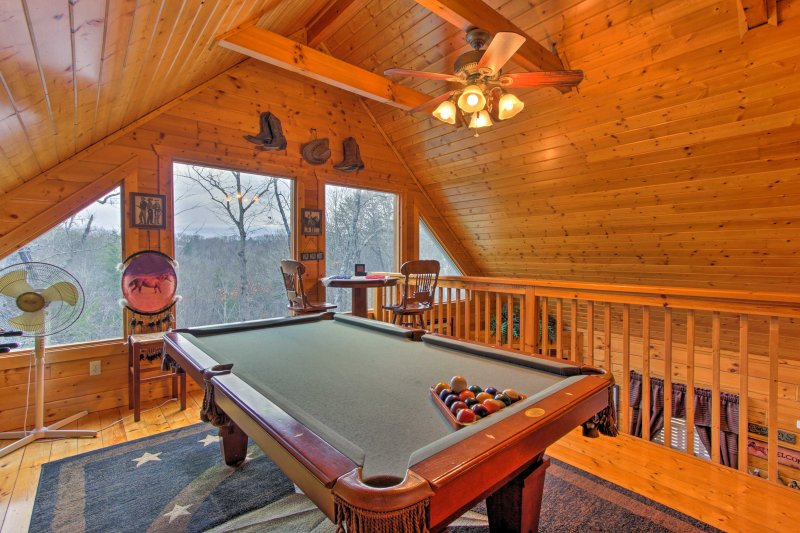 The game room features a pool table, Playstation 2, and assorted board games!