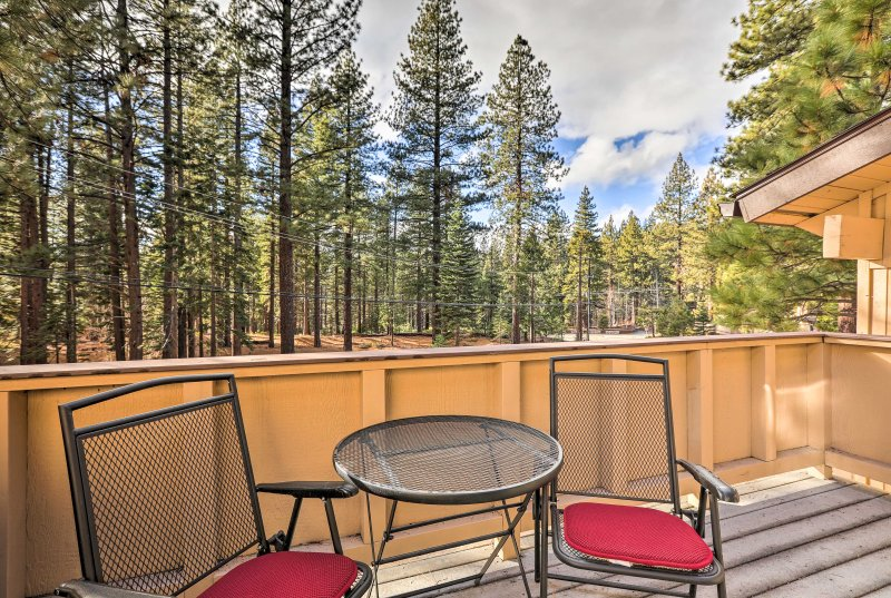 Relax on the private deck with views overlooking the pines.