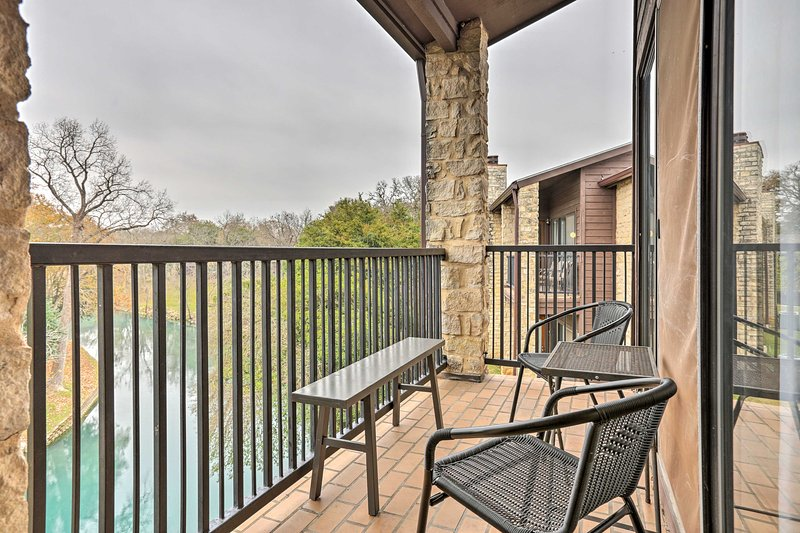 Escape to New Braunfels at this 2-bedroom, 2-bathroom vacation rental condo that's across the street from Schlitterbahn Waterpark!