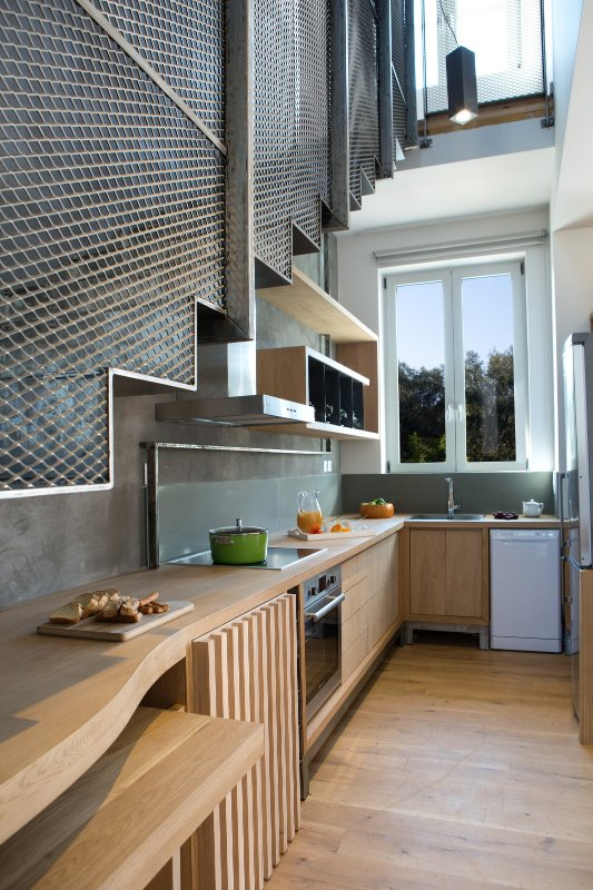 The Kitchen and the top designed metal staircase