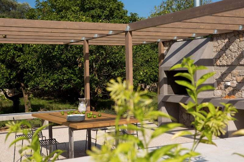The  stone built Barbeque and its sitting area in the olive grove and garden