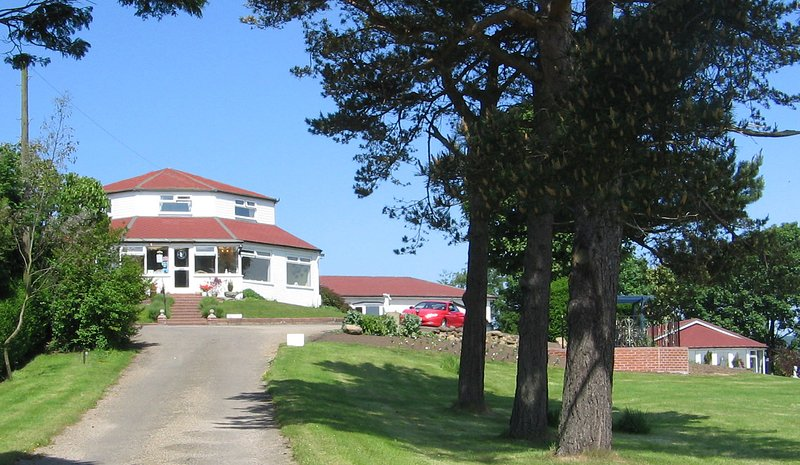 Entrance drive showing main door to reception.