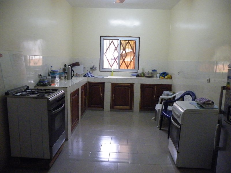 Kitchen with gas cooker and fridge and fridge/freezer.