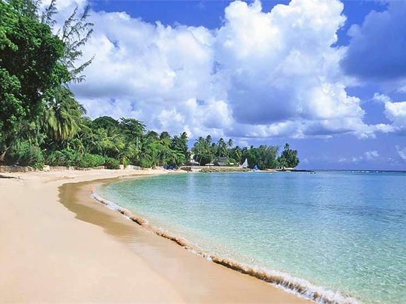 Beautiful sandy beaches are few minutes walk from the condo
