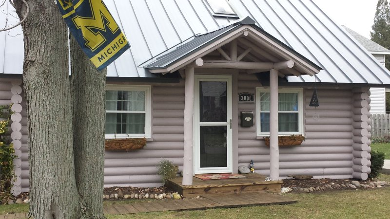 Exterior of cabin. New metal roof and windows.