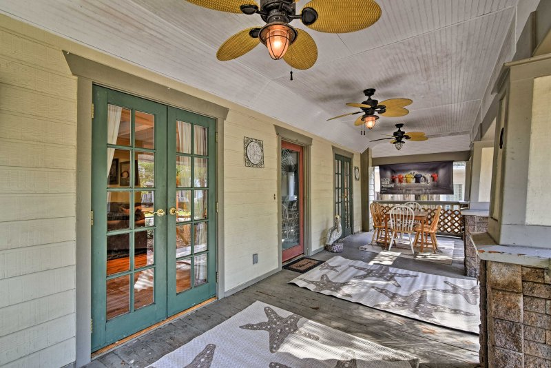 From the front deck to the back patio, this house exudes a Florida character.