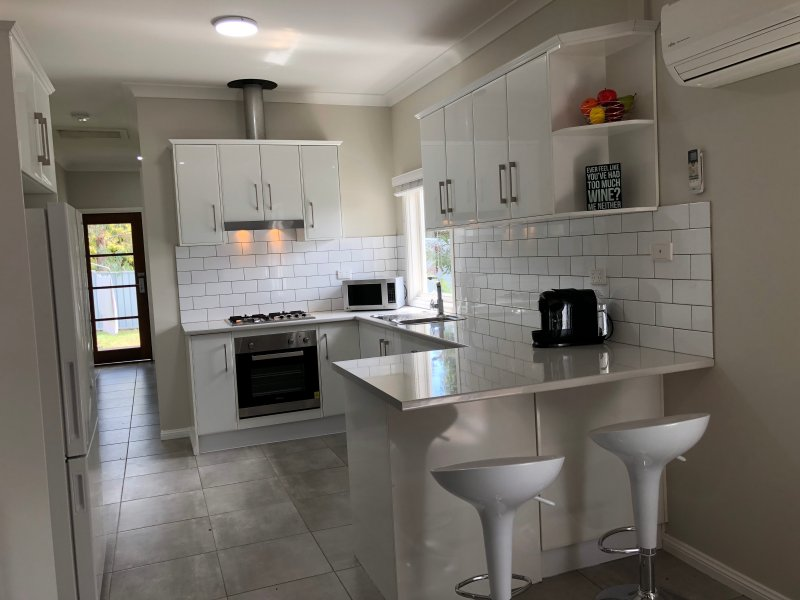 A full equipped kitchen including dishwasher, coffee machine & microwave