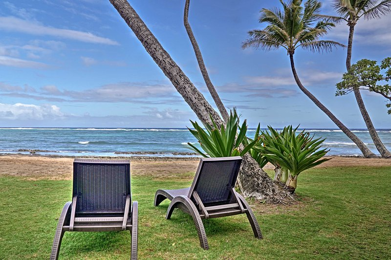 Experience stunning natural beauty from your home base at this 2-bedroom, 1-bathroom vacation rental condo in Kapa'a!