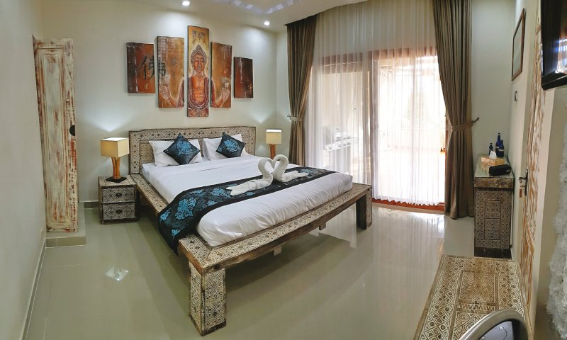 Blue room furniture from exclusive home design.Teak handmade carving.Free wifi in the villa