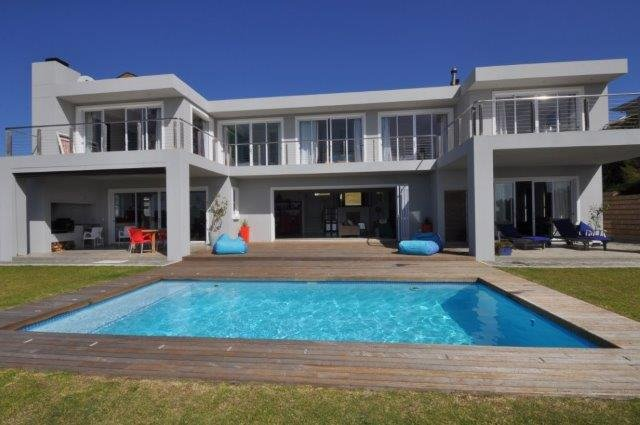 The house with pool, deck and patios