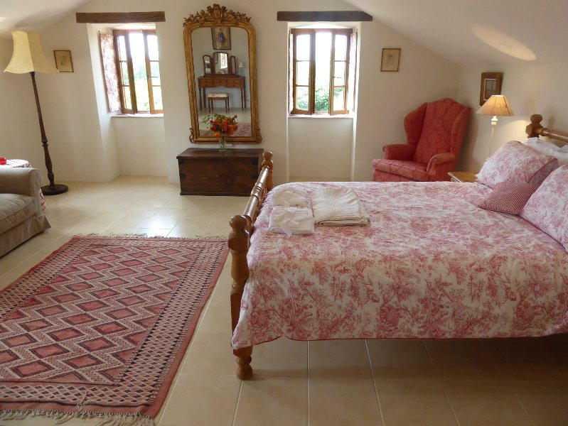 Luxurious master suite with ensuite bathroom and dressing room overlooking the grounds