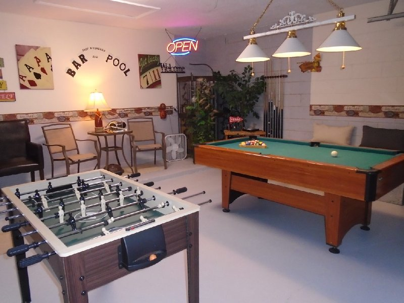 Games Area with pool, darts, Foosball and small air hockey table.