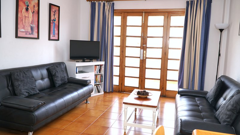 Separate living room with flat screen TV which receives UK television.