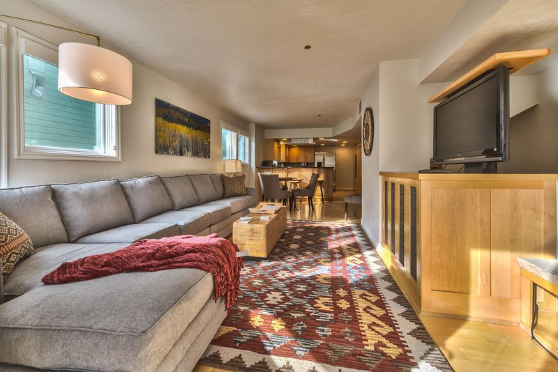 Living Room with Comfortable Furnishings, Large Flat Screen TV and Gas Fireplace