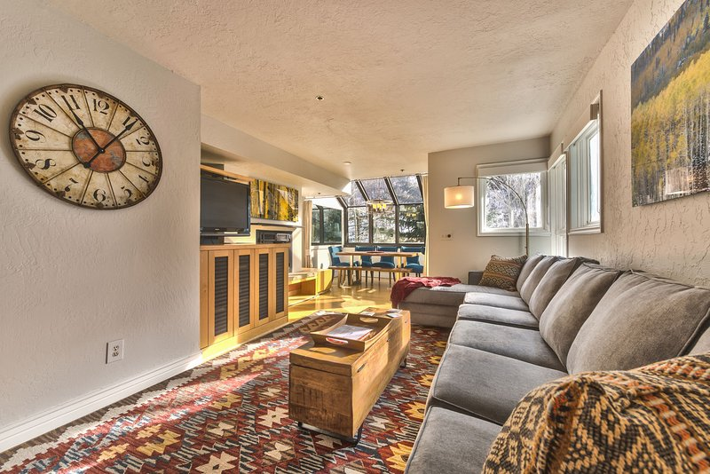 Living Room with Contemporary Furnishings, Large Flat Screen TV and Gas Fireplace