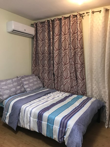 Cheap stay in a resort living at San Remo Oasis Condo, holiday rental in Pinamungajan