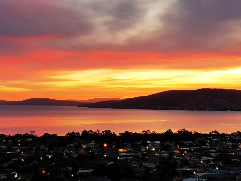 Enjoy the beautiful colours as the sun sets over the Derwent River and Hobart from Charbella's.