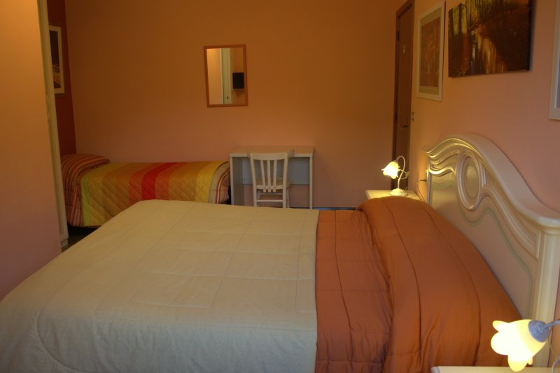 Double room with extra single bed (ensuite bathroom). Double room with extra bed.