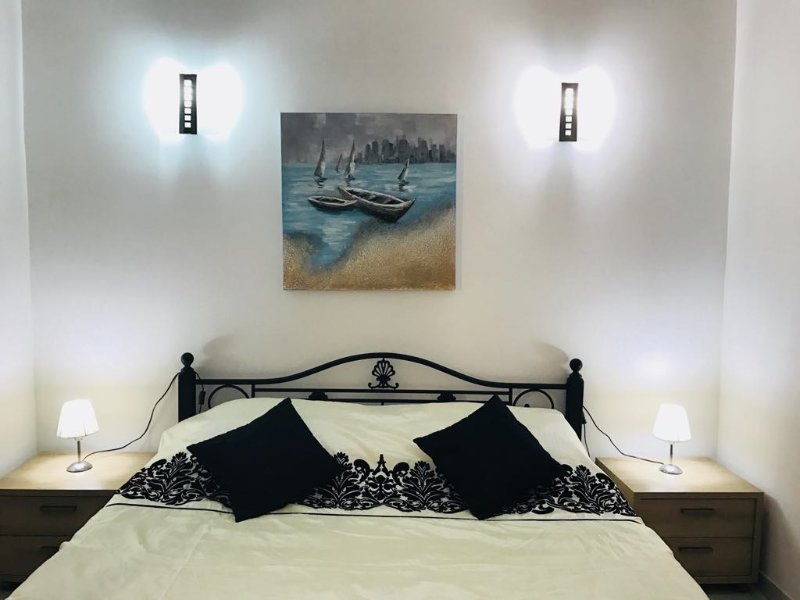 Queen size bed in air conditioned room