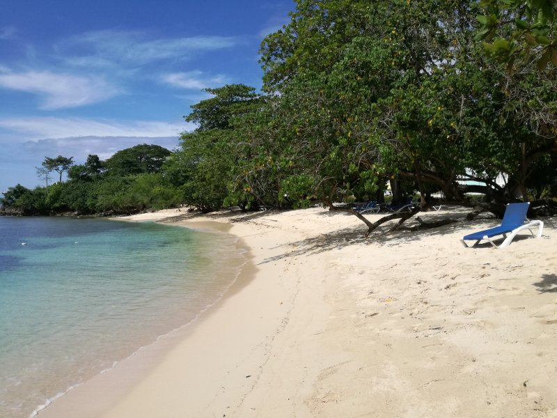 Beautiful, white sand relaxing private beach adjacent to infinity pool.