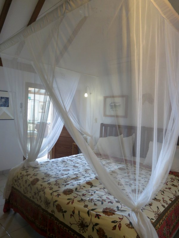 main bedroom with en-suite and A/C has private access to wrap around veranda