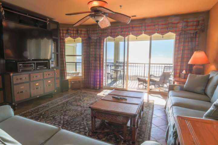 Enjoy the big screen TV and beautiful decor of our beachfront condo!
