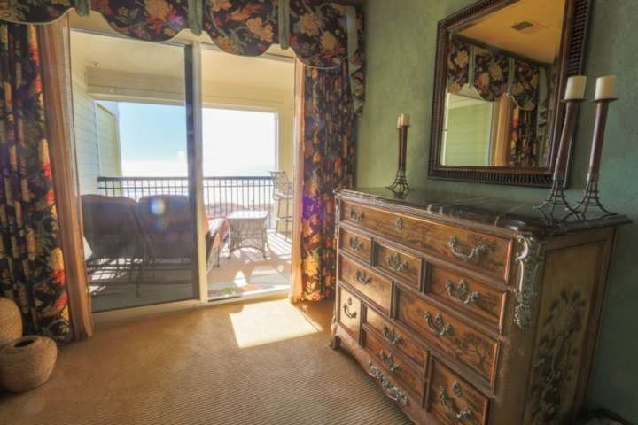 Walk out of the sliding door in the master bedroom and onto the oceanfront balcony.