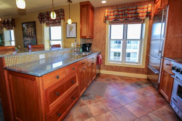Cook a feast in this beautiful galley kitchen with the Viking oven & stove and Sub-Zero refrigerator.