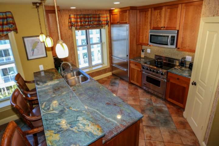 You'll love the kitchen's granite countertops, tiled backsplash and cork-lined walls.