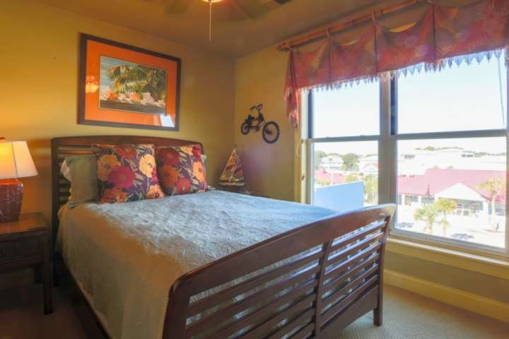 Guests love the tropical colors and bamboo-themed decor in this full-sized guest bedroom.