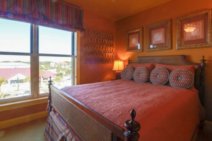 This guest bedroom with a full-sized bed overlooks the street side of the building.
