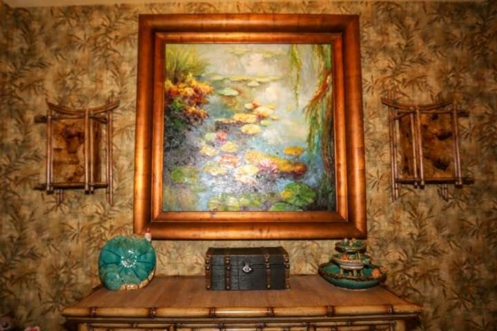 The Asian-influenced art & decor in the home's entryway welcomes you when you arrive.